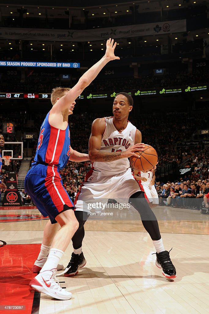 DeMar DeRozan #10 of the Toronto Raptors handles the ball against the Detroit Pistons on March 12, 2014 at the Air Canada Centre in Toronto, Ontario, Canada.