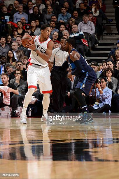 DeMar DeRozan of the Toronto Raptors handles the ball against the Dallas Mavericks on December 22 2015 at the Air Canada Centre in Toronto Ontario...
