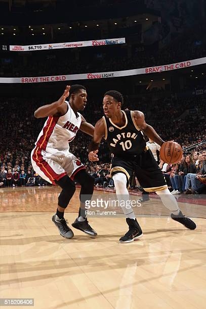 DeMar DeRozan of the Toronto Raptors handles the ball against the Miami Heat on March 12 2016 at the Air Canada Centre in Toronto Ontario Canada NOTE...