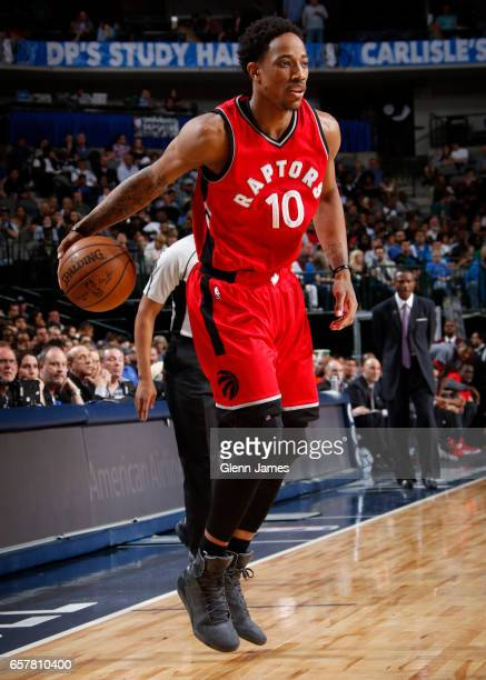 DeMar DeRozan of the Toronto Raptors handles the ball against the Dallas Mavericks on March 25 2017 at the American Airlines Center in Dallas Texas...