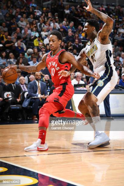 DeMar DeRozan of the Toronto Raptors handles the ball against the Denver Nuggets on November 1 2017 at the Pepsi Center in Denver Colorado NOTE TO...