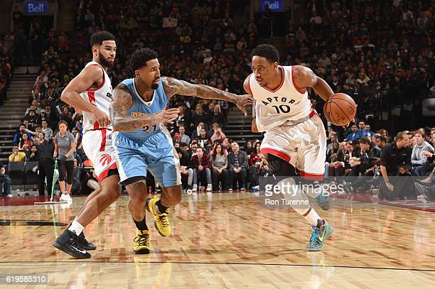 DeMar DeRozan of the Toronto Raptors handles the ball against Wilson Chandler of the Denver Nuggets during a game on October 31 2016 at the Air...