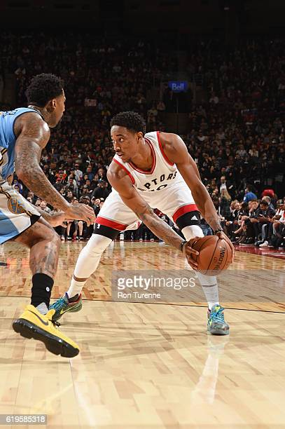 DeMar DeRozan of the Toronto Raptors handles the ball during a game against the Denver Nuggets on October 31 2016 at the Air Canada Centre in Toronto...
