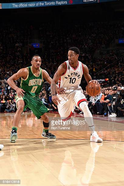 DeMar DeRozan of the Toronto Raptors handles the ball during the game against the Boston Celtics on March 18 2016 at the Air Canada Centre in Toronto...