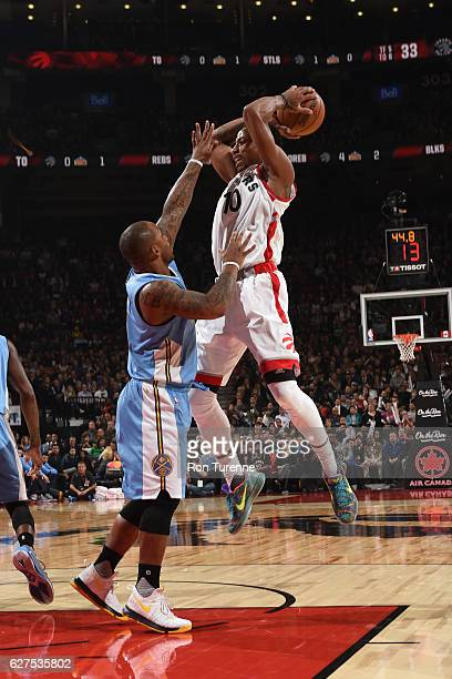 DeMar DeRozan of the Toronto Raptors handles the ball during the game against the Denver Nuggets on October 31 2016 at the Air Canada Centre in...