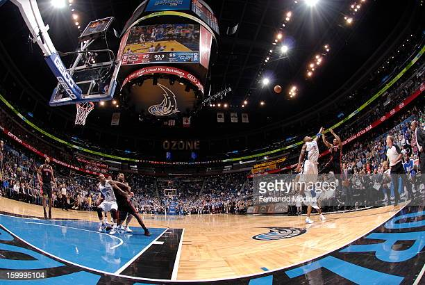 DeMar DeRozan of the Toronto Raptors hits the game winning shot against Glen Davis of the Orlando Magic during the game on January 24 2013 at Amway...