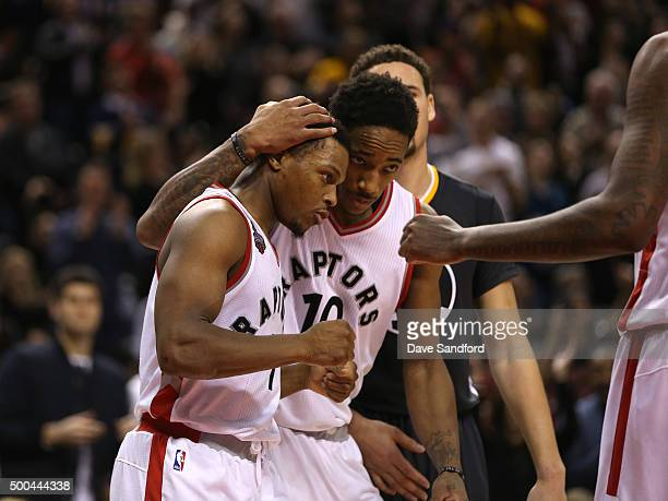 DeMar DeRozan of the Toronto Raptors hugs teammate Kyle Lowry during the game against the Golden State Warriors on December 5 2015 at Air Canada...
