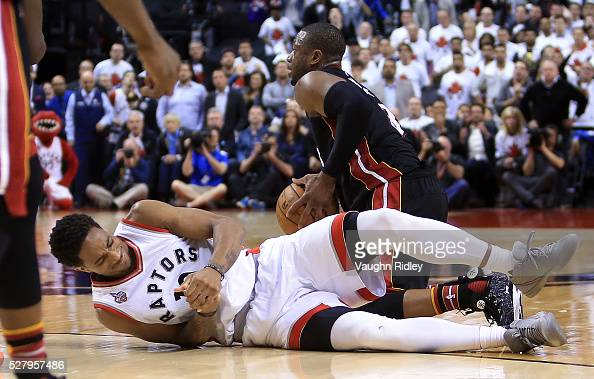 DeMar DeRozan of the Toronto Raptors injures his hand late in the second half of Game One of the Eastern Conference Semifinals against the Miami Heat...
