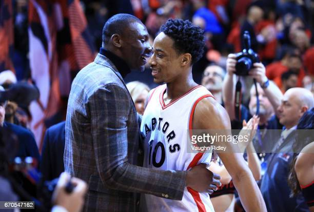 DeMar DeRozan of the Toronto Raptors is congratulated by former Raptor Bismack Biyombo following Game Two of the Eastern Conference Quarterfinals...
