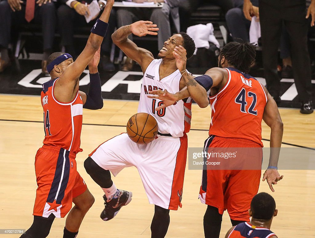TORONTO, ON- APRIL 18 - DeMar DeRozan (10) of the Toronto Raptors is fouled by Nene Hilario (42) of the Washington Wizards during the game between the Toronto Raptors and the Washington Wizards at the Air Canada Centre April 18, 2015