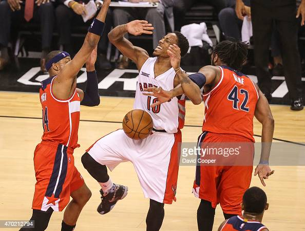 TORONTO ON APRIL 18 DeMar DeRozan of the Toronto Raptors is fouled by Nene Hilario of the Washington Wizards during the game between the Toronto...