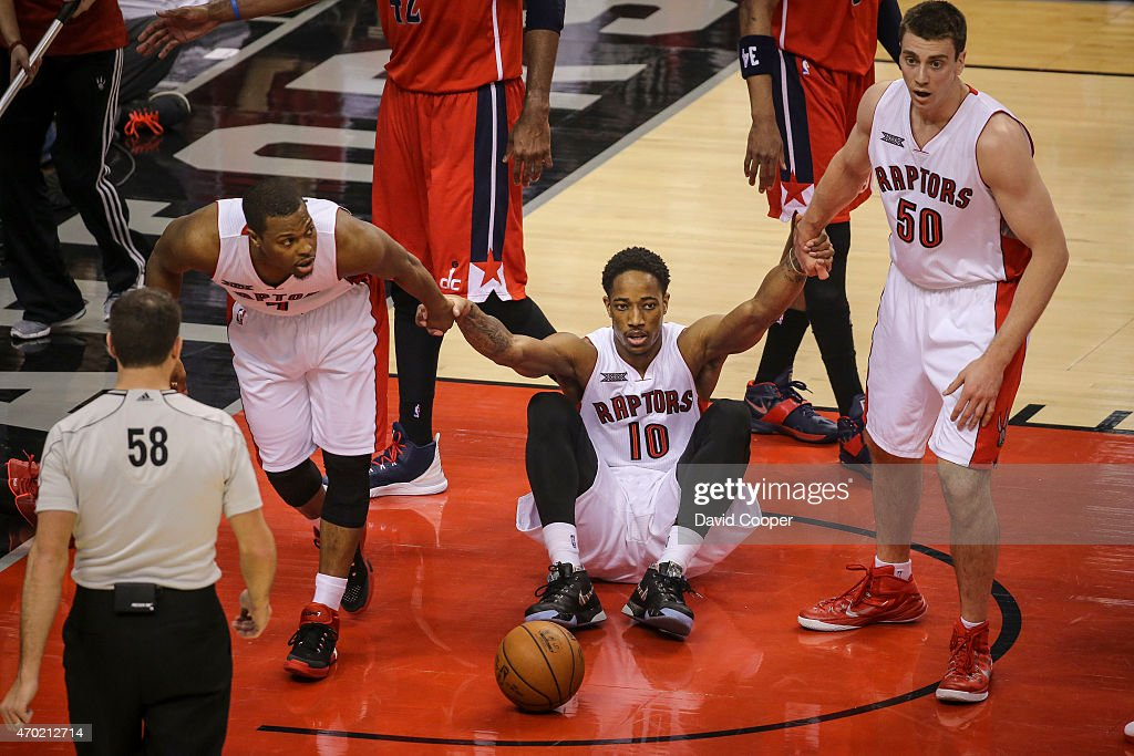 TORONTO, ON- APRIL 18 - DeMar DeRozan (10) of the Toronto Raptors is helped up to his feet by <a gi-track='captionPersonalityLinkClicked' href=/galleries/search?phrase=Kyle+Lowry&family=editorial&specificpeople=714625 ng-click='$event.stopPropagation()'>Kyle Lowry</a> (7) and <a gi-track='captionPersonalityLinkClicked' href=/galleries/search?phrase=Tyler+Hansbrough&family=editorial&specificpeople=642794 ng-click='$event.stopPropagation()'>Tyler Hansbrough</a> (50) after he was fouled during the game between the Toronto Raptors and the Washington Wizards at the Air Canada Centre April 18, 2015