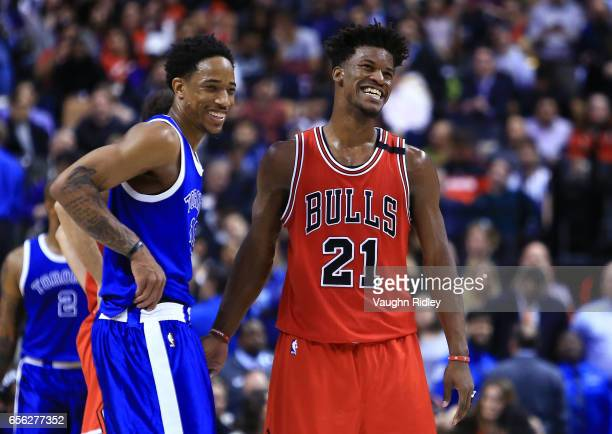 DeMar DeRozan of the Toronto Raptors laughs with Jimmy Butler of the Chicago Bulls during the second half of an NBA game at Air Canada Centre on...
