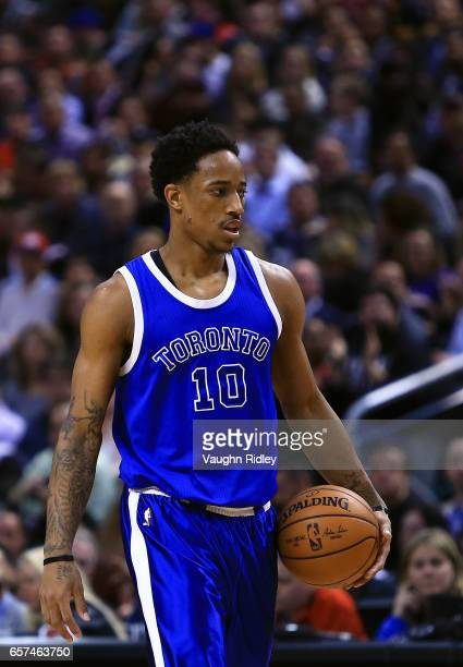 DeMar DeRozan of the Toronto Raptors looks on during the first half of an NBA game against the Chicago Bulls at Air Canada Centre on March 21 2017 in...