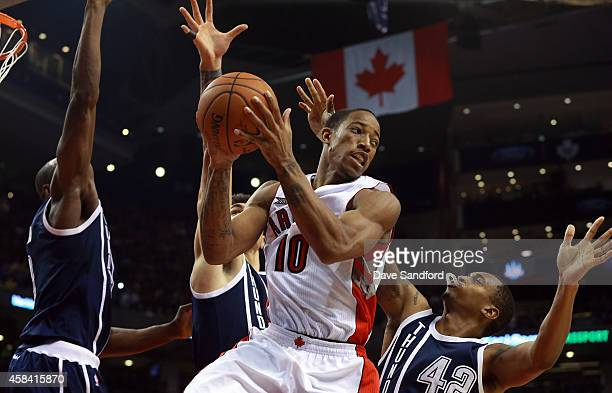 DeMar DeRozan of the Toronto Raptors looks to make a pass as Lance Thomas Nick Collison and Serge Ibaka all of the Oklahoma City Thunder defend...
