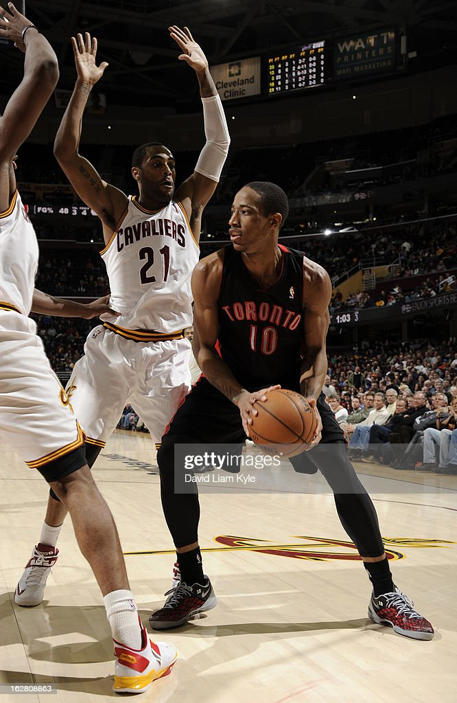 DeMar DeRozan #10 of the Toronto Raptors looks to pass the ball against Wayne Ellington #21 of the Cleveland Cavaliers at The Quicken Loans Arena on February 27, 2013 in Cleveland, Ohio.