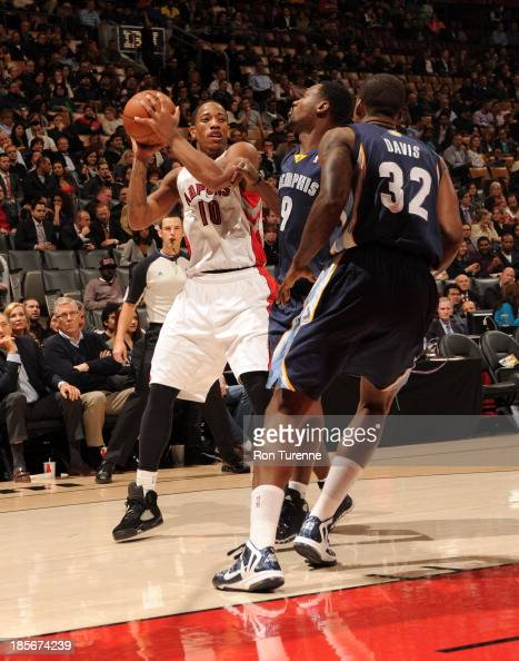 DeMar DeRozan of the Toronto Raptors looks to pass the ball against Tony Allen and Ed Davis of the Memphis Grizzlies during the game on October 23...