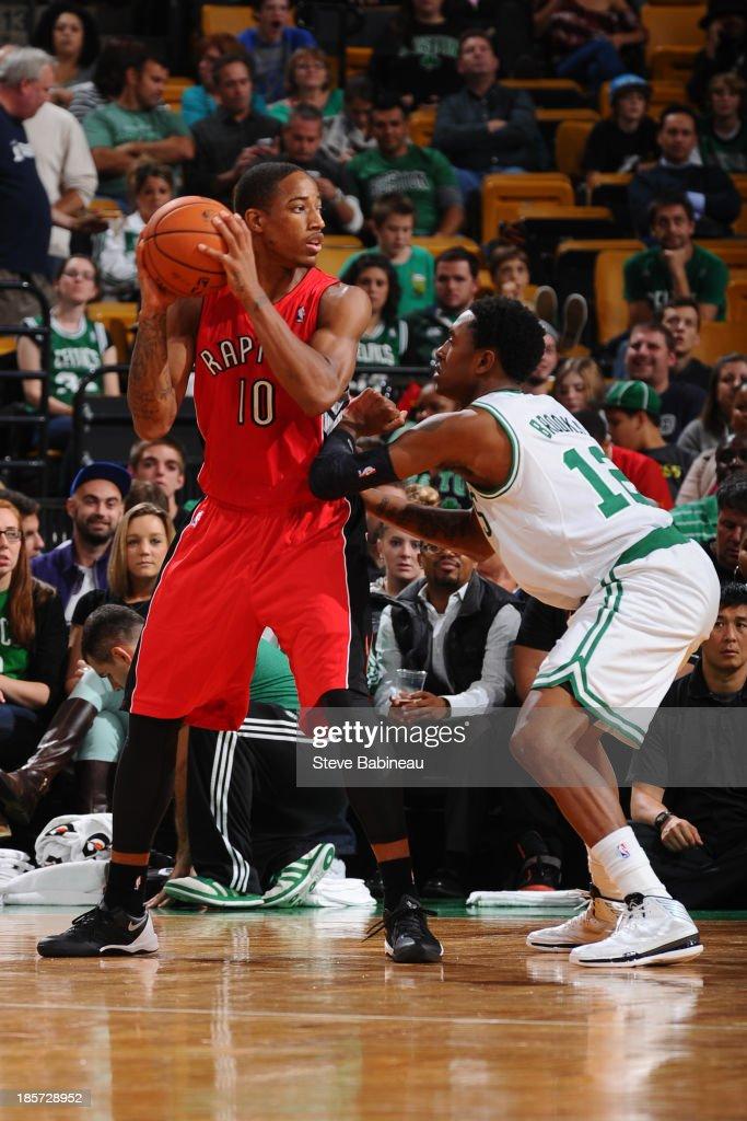 DeMar DeRozan #10 of the Toronto Raptors looks to pass the ball against the Boston Celtics on October 7, 2013 at the TD Garden in Boston, Massachusetts.