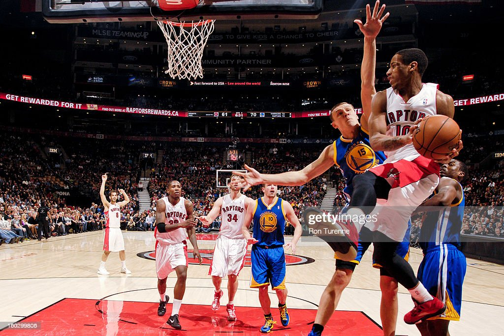 DeMar DeRozan #10 of the Toronto Raptors looks to pass the ball in the lane against Andris Biedrins #15 of the Golden State Warriors on January 28, 2013 at the Air Canada Centre in Toronto, Ontario, Canada.
