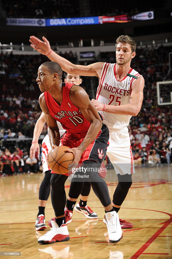 DeMar DeRozan #10 of the Toronto Raptors looks to shoot against <a gi-track='captionPersonalityLinkClicked' href=/galleries/search?phrase=Chandler+Parsons&family=editorial&specificpeople=4249869 ng-click='$event.stopPropagation()'>Chandler Parsons</a> #25 of the Houston Rockets on November 27, 2012 at the Toyota Center in Houston, Texas.