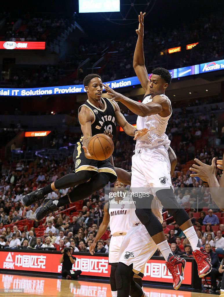 DeMar DeRozan #10 of the Toronto Raptors passes away from <a gi-track='captionPersonalityLinkClicked' href=/galleries/search?phrase=Hassan+Whiteside&family=editorial&specificpeople=7068411 ng-click='$event.stopPropagation()'>Hassan Whiteside</a> #21 of the Miami Heat during a game at American Airlines Arena on December 18, 2015 in Miami, Florida.