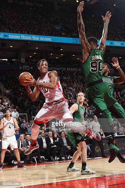 DeMar DeRozan of the Toronto Raptors passes the ball against the Boston Celticson January 20 2016 at the Air Canada Centre in Toronto Ontario Canada...