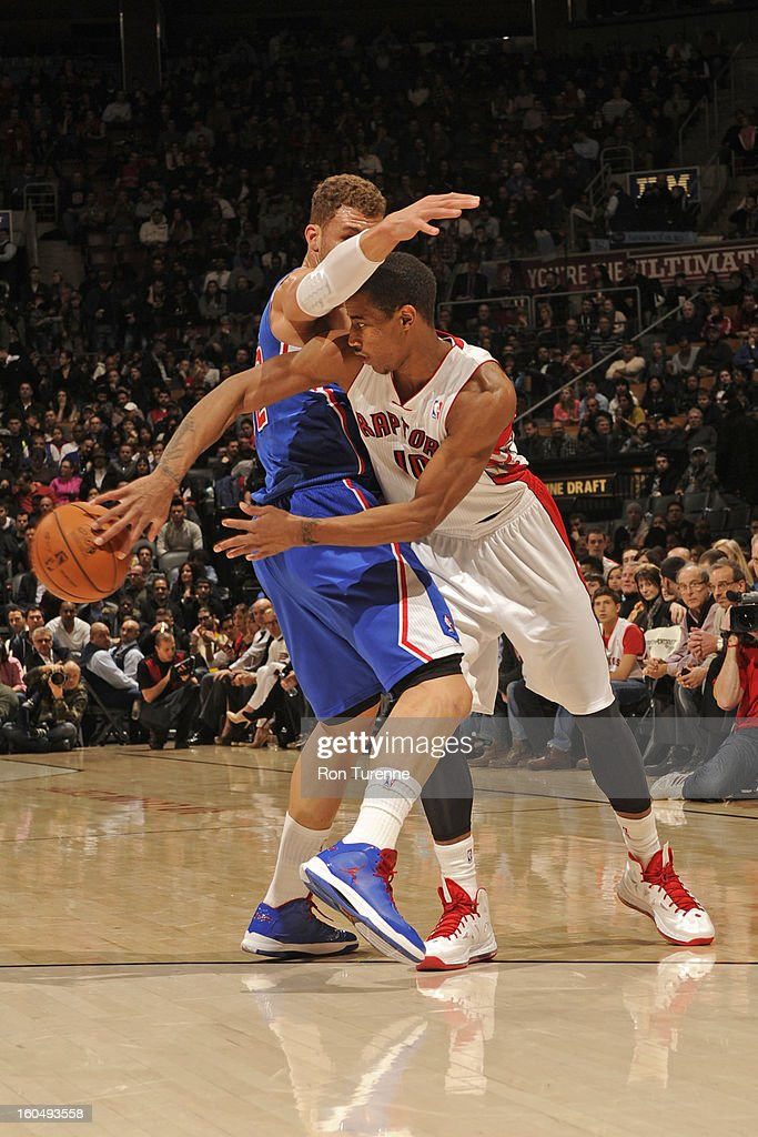 DeMar DeRozan #10 of the Toronto Raptors passes the ball around Blake Griffin #32 of the Los Angeles Clippers on February 1, 2013 at the Air Canada Centre in Toronto, Ontario, Canada.