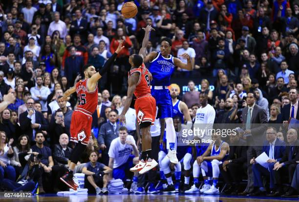 DeMar DeRozan of the Toronto Raptors passes the ball as Denzel Valentine and Rajon Rondo of the Chicago Bulls defend during overtime of an NBA game...