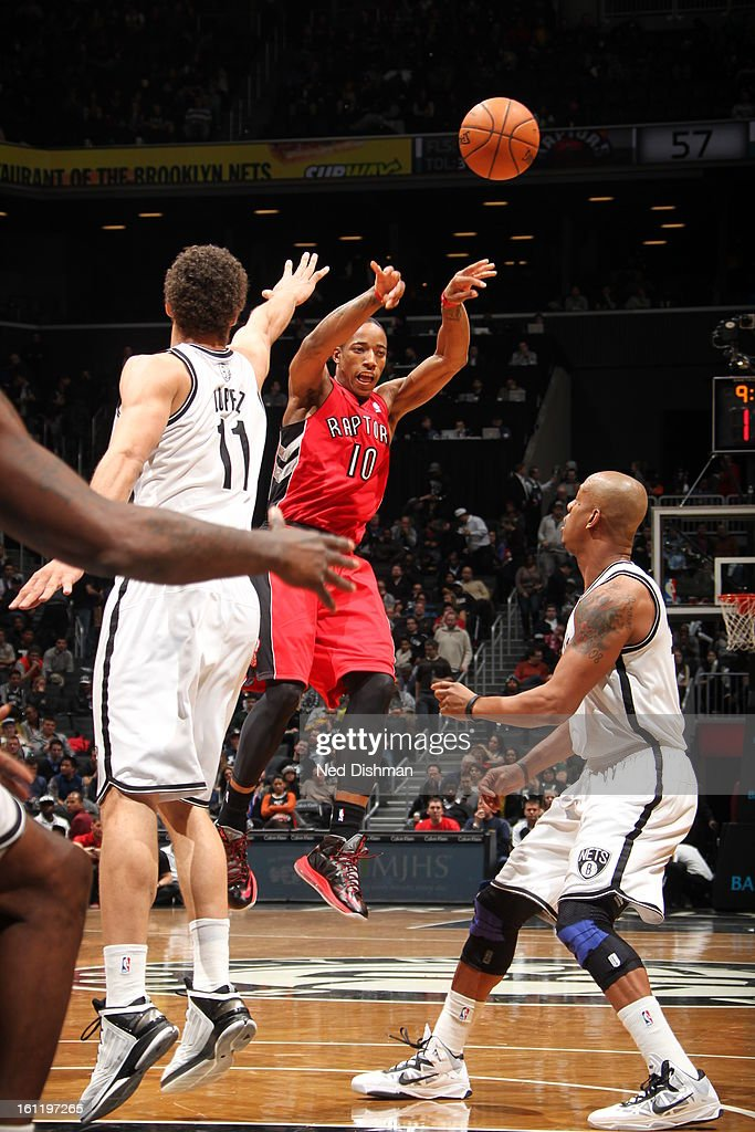 DeMar DeRozan #10 of the Toronto Raptors passes the ball in mid-air against the Brooklyn Nets at the Barclays Center on January 15, 2013 in the Brooklyn borough of New York City in New York City.