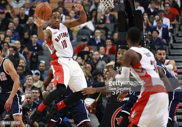 DeMar DeRozan of the Toronto Raptors passes the ball off to Terrence Ross of the Toronto Raptors during their game at Air Canada Centre on November 4...