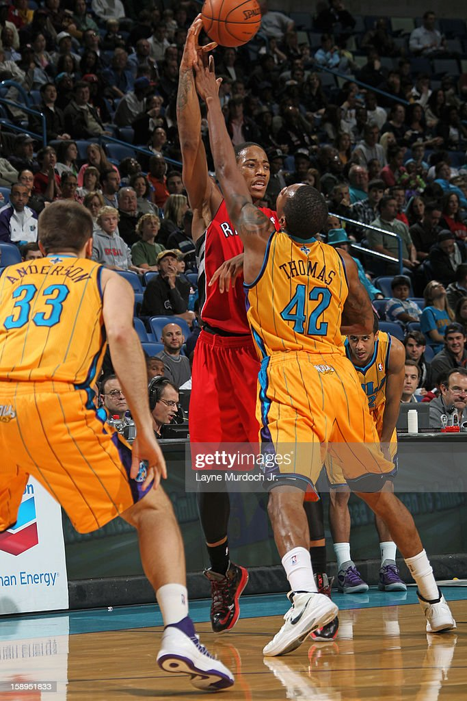 DeMar DeRozan #10 of the Toronto Raptors passes the ball over Lance Thomas #42 of the New Orleans Hornets on December 28, 2012 at the New Orleans Arena in New Orleans, Louisiana.