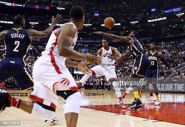DeMar DeRozan of the Toronto Raptors passes the ball to Kyle Lowry during the NBA season opener against the Indiana Pacers at Air Canada Centre on...
