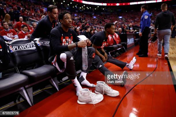 DeMar DeRozan of the Toronto Raptors puts on his shoes before Game Two of the Eastern Conference Quarterfinals against the Milwaukee Bucks during the...