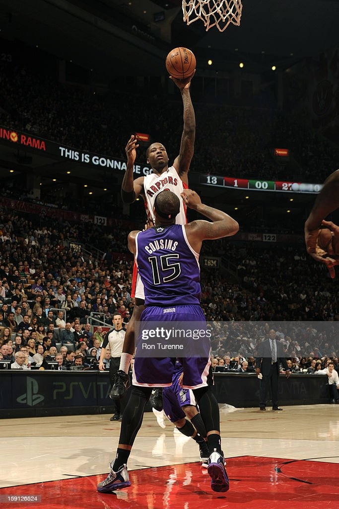 DeMar DeRozan #10 of the Toronto Raptors puts up a shot over <a gi-track='captionPersonalityLinkClicked' href=/galleries/search?phrase=DeMarcus+Cousins&family=editorial&specificpeople=5792008 ng-click='$event.stopPropagation()'>DeMarcus Cousins</a> #15 of the Sacramento Kings on January 4, 2013 at the Air Canada Centre in Toronto, Ontario, Canada.