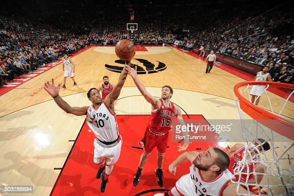 DeMar DeRozan of the Toronto Raptors reaches for the ball against Pau Gasol of the Chicago Bulls during the game on January 3 2016 at Air Canada...