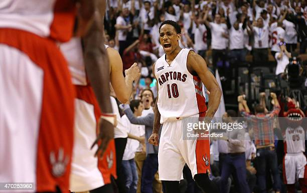DeMar DeRozan of the Toronto Raptors reacts to a late game tying basket against the Washington Wizards during game one of their NBA Eastern...