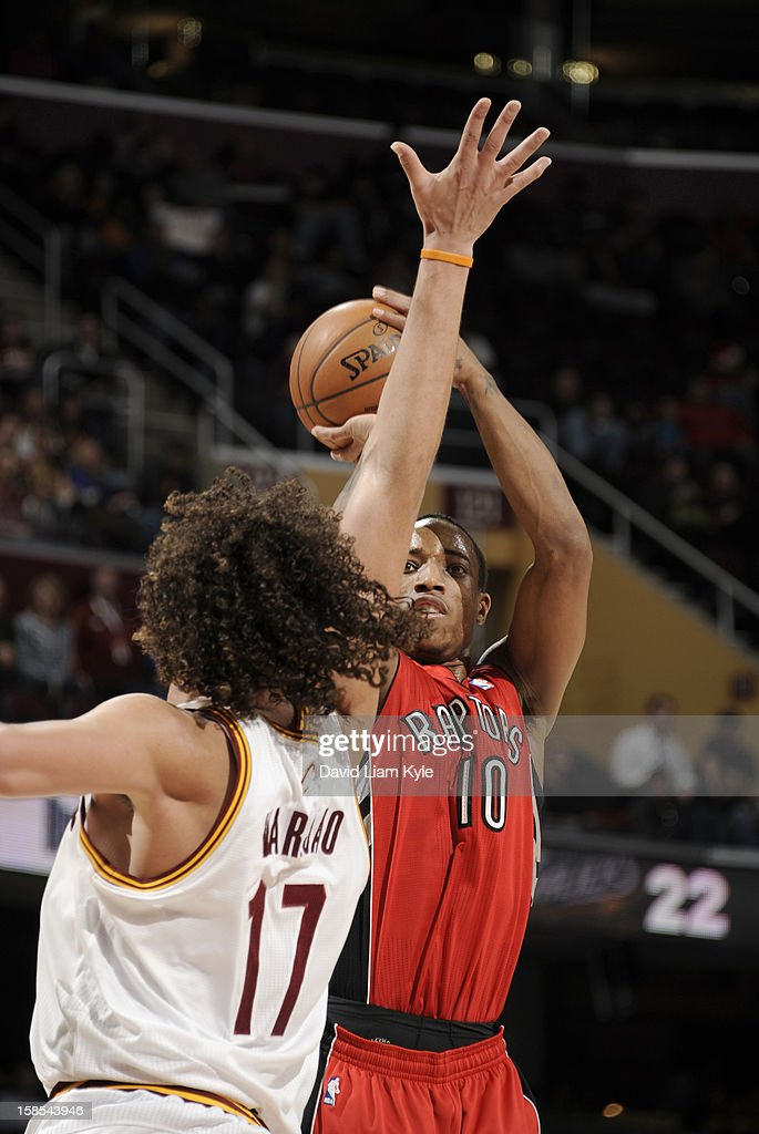 DeMar DeRozan #10 of the Toronto Raptors shoots a jumper against <a gi-track='captionPersonalityLinkClicked' href=/galleries/search?phrase=Anderson+Varejao&family=editorial&specificpeople=202247 ng-click='$event.stopPropagation()'>Anderson Varejao</a> #17 of the Cleveland Cavaliers at The Quicken Loans Arena on December 18, 2012 in Cleveland, Ohio.