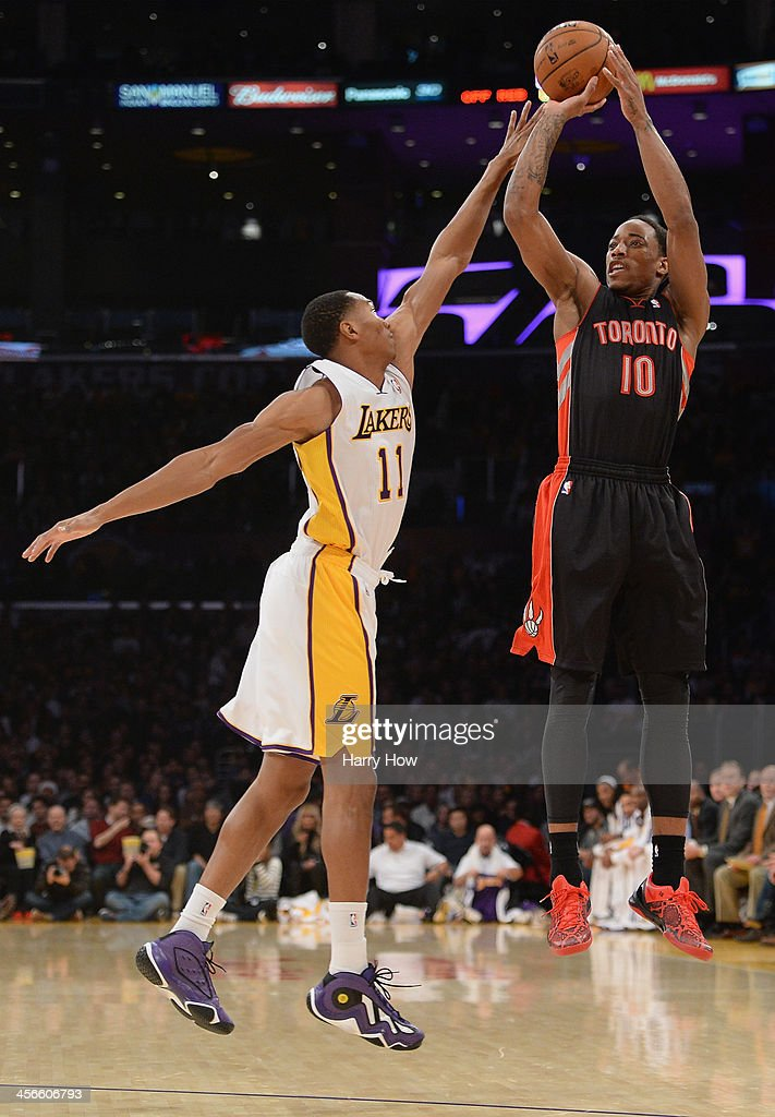 DeMar DeRozan #10 of the Toronto Raptors shoots a jumper in front of <a gi-track='captionPersonalityLinkClicked' href=/galleries/search?phrase=Wesley+Johnson+-+Basketball+Player&family=editorial&specificpeople=4184049 ng-click='$event.stopPropagation()'>Wesley Johnson</a> #11 of the Los Angeles Lakers at Staples Center on December 8, 2013 in Los Angeles, California.
