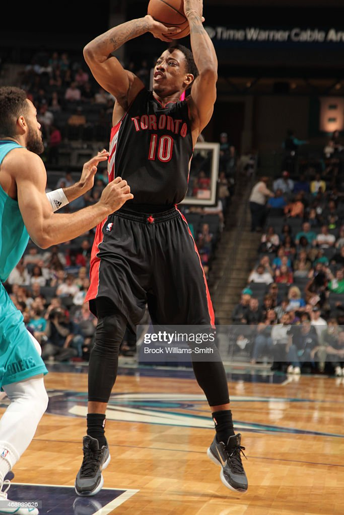 DeMar DeRozan of the Toronto Raptors shoots against Jeff Taylor of the Charlotte Hornets during the game at the Time Warner Cable Arena on April 8...