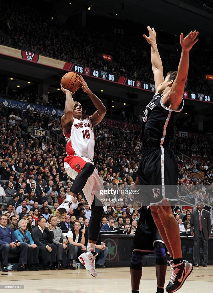 DeMar DeRozan #10 of the Toronto Raptors shoots against Kris Humphries #43 of the Brooklyn Nets on December 12, 2012 at the Air Canada Centre in Toronto, Ontario, Canada.