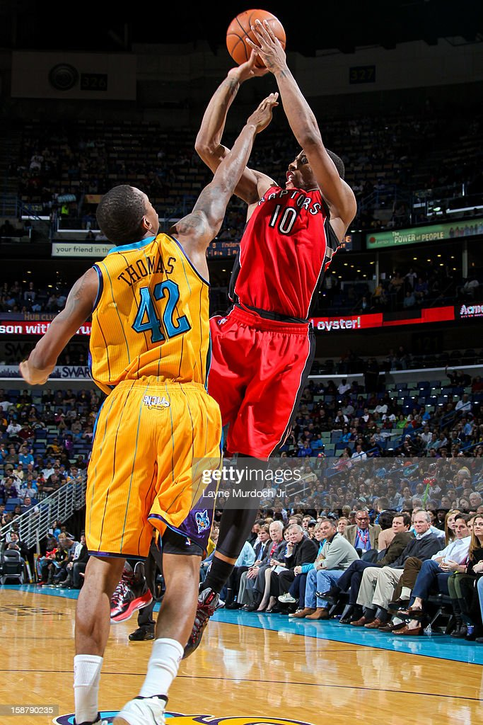 DeMar DeRozan #10 of the Toronto Raptors shoots against Lance Thomas #42 of the New Orleans Hornets on December 28, 2012 at the New Orleans Arena in New Orleans, Louisiana.