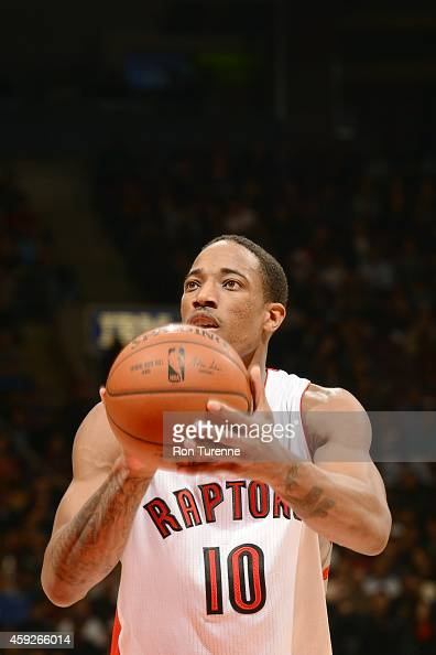 DeMar DeRozan of the Toronto Raptors shoots against the Memphis Grizzlies during the game on November 19 2014 at Air Canada Centre in Toronto Canada...