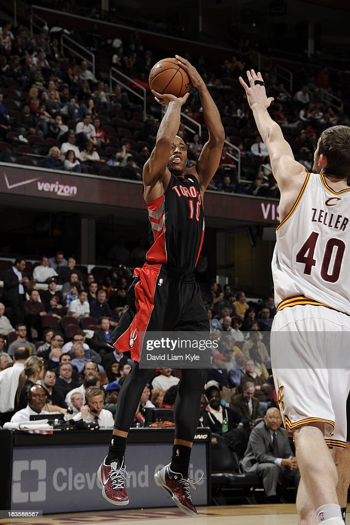 DeMar DeRozan #10 of the Toronto Raptors shoots against <a gi-track='captionPersonalityLinkClicked' href=/galleries/search?phrase=Tyler+Zeller&family=editorial&specificpeople=5122156 ng-click='$event.stopPropagation()'>Tyler Zeller</a> #40 of the Cleveland Cavaliers at The Quicken Loans Arena on February 27, 2013 in Cleveland, Ohio.