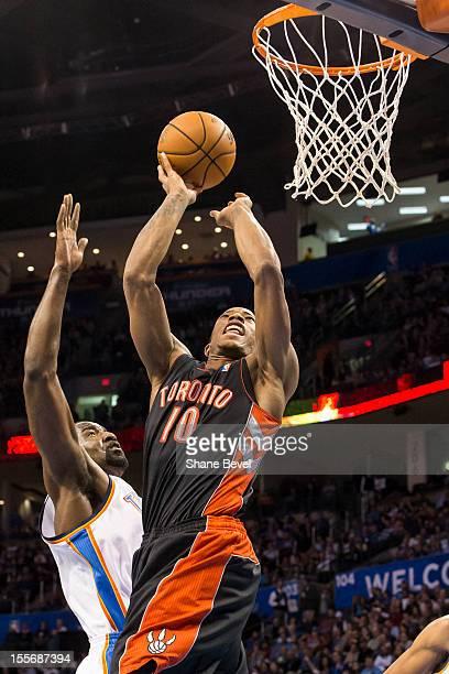 DeMar DeRozan of the Toronto Raptors shoots as he collides with Serge Ibaka of the Oklahoma City Thunder during the NBA basketball game on November 6...