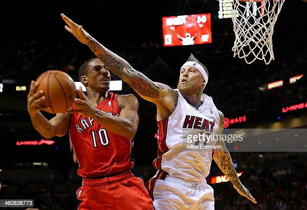 DeMar DeRozan of the Toronto Raptors shoots over Chris Andersen of the Miami Heat during a agame at AmericanAirlines Arena on January 5 2014 in Miami...