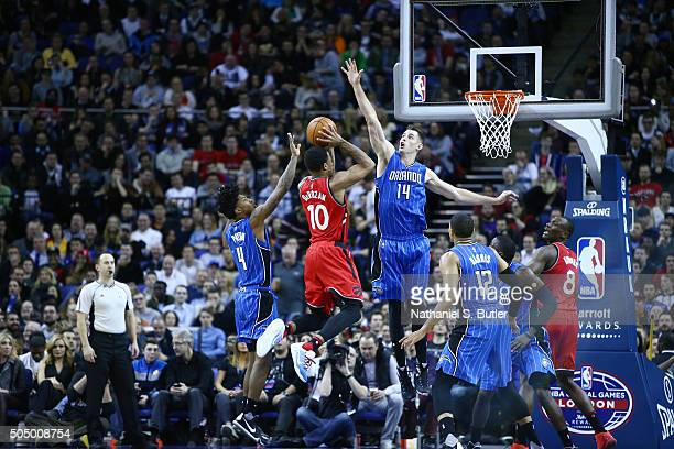 DeMar DeRozan of the Toronto Raptors shoots the ball against Jason Smith of the Orlando Magic as part of the 2016 Global Games London on January 14...