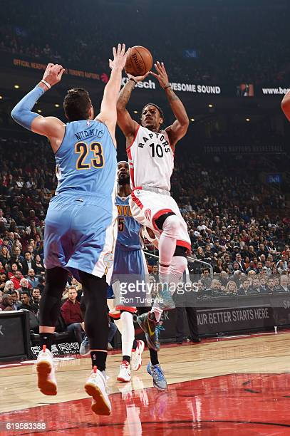 DeMar DeRozan of the Toronto Raptors shoots the ball against Jusuf Nurkic of the Denver Nuggets during a game on October 31 2016 at the Air Canada...