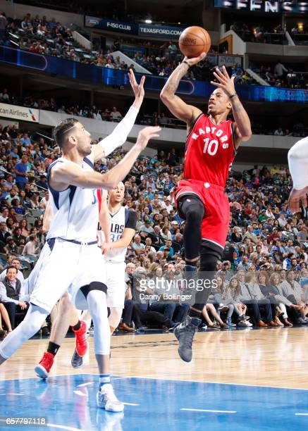 DeMar DeRozan of the Toronto Raptors shoots the ball against the Dallas Mavericks on March 25 2017 at the American Airlines Center in Dallas Texas...
