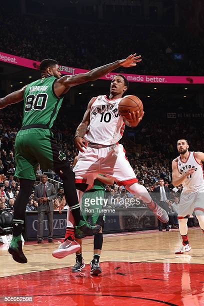DeMar DeRozan of the Toronto Raptors shoots the ball against the Boston Celticson January 20 2016 at the Air Canada Centre in Toronto Ontario Canada...