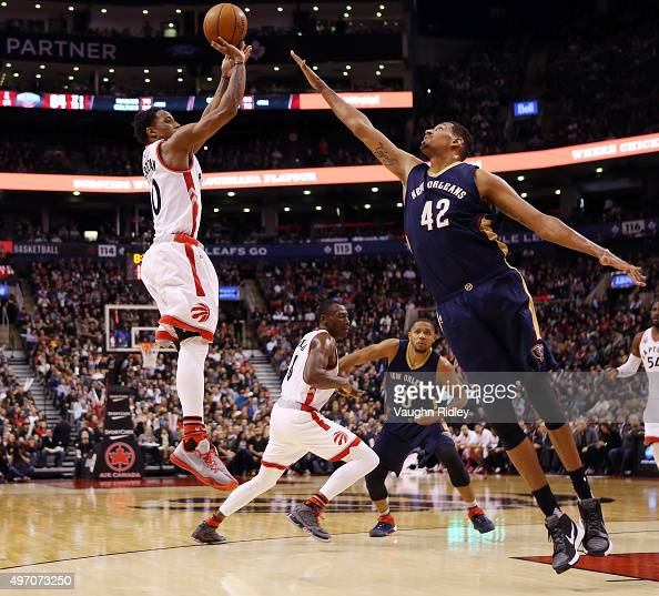 DeMar DeRozan of the Toronto Raptors shoots the ball as Alexis Ajinca of the New Orleans Pelicans defends during an NBA game at the Air Canada Centre...